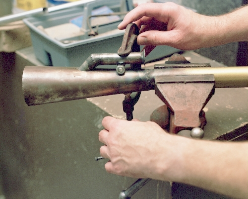Jigging the intake to the chamber cone with a bolt, nut and C-clamp - Photo (c) 2004 Larry Cottrill