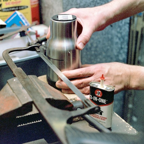 Cutting the groove around the mug shell, to cut excess length from the diffuser section (c) 2003 Larry Cottrill