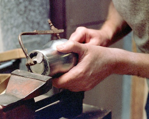 Cutting out the end of the diffuser section, using the jeweler's saw (c) 2003 Larry Cottrill