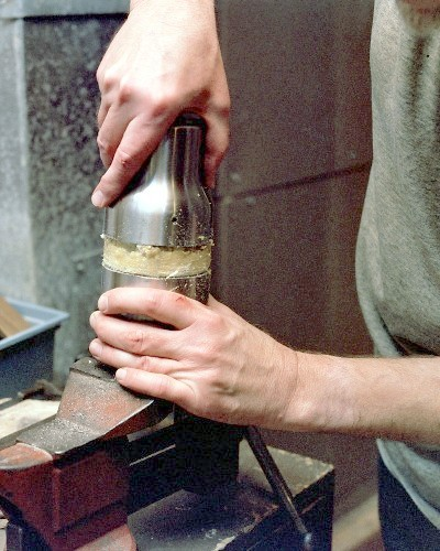 Pulling the fully cut diffuser section off the mug insulation, with some difficulty (c) 2003 Larry Cottrill