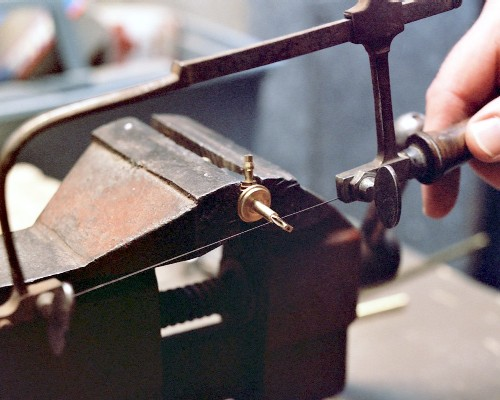 Cutting off the short machined end of the needle valve body (c) 2003 Larry Cottrill